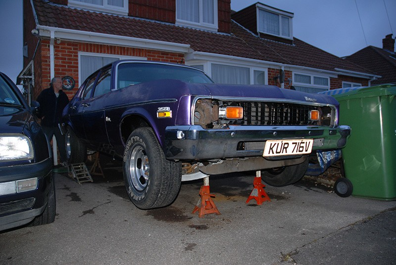 Chevy Nova on axle stands, nearing the end of its work